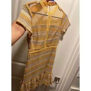Yellow crochet mini dress